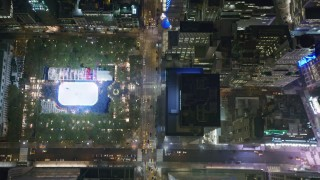 AX123_064 - 6K stock footage aerial video of a bird's eye of 6th Avenue in Midtown and reveal Bryant Park at Night