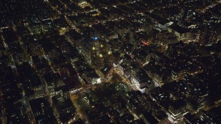 AX123_069 - 6K stock footage aerial video orbit Beth Israel Medical Center and Union Square in Gramercy at Night in New York City