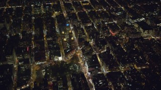 AX123_070 - 6K stock footage aerial video orbit of Union Square and Beth Israel Medical Center at Night in Gramercy, New York City