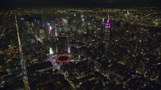 AX123_076 - 6K stock footage aerial video of Madison Square Garden and tall Midtown towers at Night in New York City