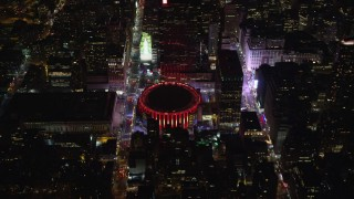 AX123_077 - 5.5K stock footage aerial video of orbiting Madison Square Garden at Night in Midtown, New York City