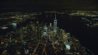 AX123_082 - 6K stock footage aerial video of approaching One World Trade Center in Lower Manhattan at Night in New York City