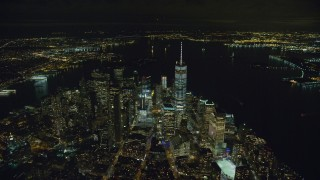 AX123_083 - 6K stock footage aerial video of One World Trade Center in Lower Manhattan at Night in New York City
