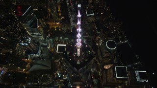 AX123_084 - 5.5K stock footage aerial video approach Freedom Tower and tilt to reveal the Memorial at Night, Lower Manhattan, NYC
