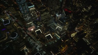 AX123_085 - 6K stock footage aerial video of a reverse view of the World Trade Center Memorial at Night in Lower Manhattan, NYC