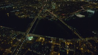AX123_090 - 6K stock footage aerial video orbit of the Brooklyn and Manhattan Bridges at Night in New York City