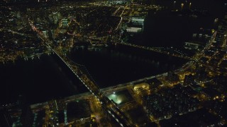 AX123_091 - 6K stock footage aerial video of an orbit of Brooklyn Bridge and Manhattan Bridge at Night, NYC