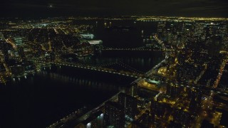 AX123_092 - 6K stock footage aerial video of orbiting the Brooklyn Bridge and the Manhattan Bridge at Night in New York City