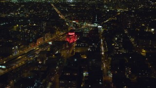 AX123_095 - 6K stock footage aerial video of approaching the historic Williamburgh Savings Bank building at Night in Brooklyn, New York City