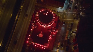 AX123_097 - 6K stock footage aerial video tilt to a bird's eye of Williamsburgh Savings Bank building at Night in Brooklyn, NYC