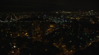 AX123_098 - 6K stock footage aerial video orbit Brooklyn public housing at Night in NYC