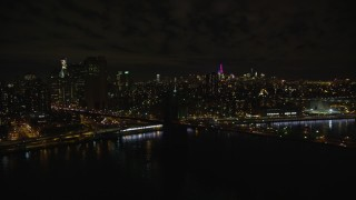 AX123_110E - 5.5K stock footage aerial video of an orbit of the Manhattan side of the Brooklyn Bridge at Night in New York City
