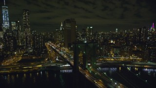 AX123_111 - 6K stock footage aerial video of orbiting the Manhattan end of Brooklyn Bridge at Night in New York City
