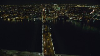 AX123_114 - 6K stock footage aerial video of orbiting the Manhattan Bridge at Night in New York City