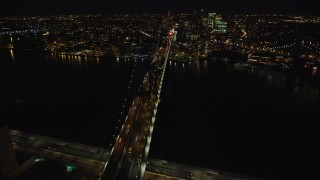 AX123_114E - 5.5K stock footage aerial video of orbiting the Manhattan Bridge at Night in New York City