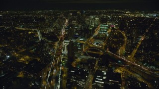 AX123_116 - 6K stock footage aerial video fly over Manhattan Bridge to approach Brooklyn at Night in New York City