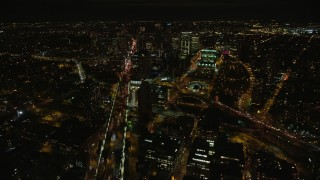 AX123_116E - 5.5K stock footage aerial video fly over Manhattan Bridge to approach Brooklyn at Night in New York City