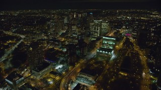 AX123_117 - 6K stock footage aerial video of skyscrapers in downtown area of Brooklyn at Night in New York City