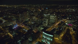 AX123_118 - 6K stock footage aerial video of flying by skyscrapers in Brooklyn at Night in New York City