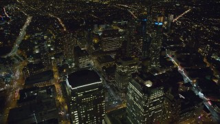 AX123_119 - 6K stock footage aerial video orbit skyscrapers in the downtown area of Brooklyn at Night, NYC