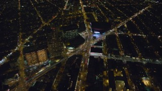 AX123_121 - 6K stock footage aerial video of the intersection of Atlantic and Flatbush Avenues by Barclays Center at Night, NYC