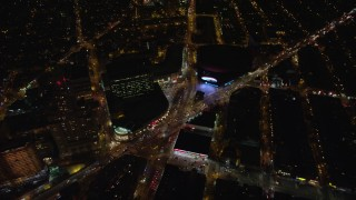 AX123_121E - 5.5K stock footage aerial video of the intersection of Atlantic and Flatbush Avenues by Barclays Center at Night, NYC