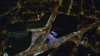 AX123_122 - 6K stock footage aerial video tilt to Barclays Center and a busy intersection at Night in Brooklyn, New York City
