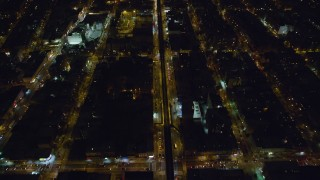 AX123_125 - 6K stock footage aerial video of bird's eye of elevated rail on Atlantic Avenue at Night in Brooklyn, New York City