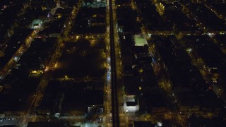 AX123_126 - 6K stock footage aerial video of a bird's eye view of elevated rail on Atlantic Avenue at Night in Brooklyn, New York City