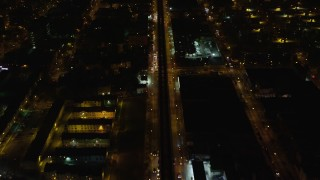AX123_127 - 6K stock footage aerial video of a bird's eye of an elevated train and Atlantic Avenue in Brooklyn at Night, New York City
