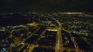 AX123_130 - 6K stock footage aerial video approach East New York Yard at Night in Brooklyn in New York City