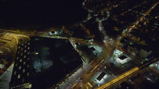 AX123_132 - 6K stock footage aerial video orbit Bushwick Avenue by East New York Yard at Night in Brooklyn in New York City