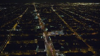 AX123_133 - 6K stock footage aerial video fly over Atlantic Avenue through Brooklyn at Night in New York City