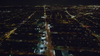 AX123_134 - 6K stock footage aerial video of flying over busy Atlantic Avenue at Night in Brooklyn in New York City
