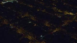 AX123_137 - 6K stock footage aerial video orbit suburban neighborhood at Night in Brooklyn in New York City