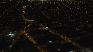 AX123_142 - 6K stock footage aerial video of suburban neighborhoods at Night in Jamaica, New York