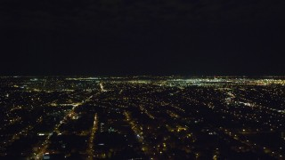 AX123_143 - 6K stock footage aerial video of a wide view of JFK International Airport at Night in New York City