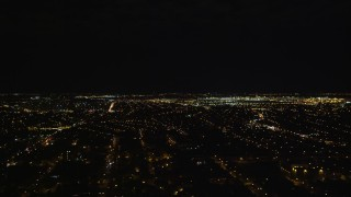 AX123_143E - 5.5K stock footage aerial video of a wide view of JFK International Airport at Night in New York City