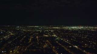 AX123_144 - 6K stock footage aerial video of John F. Kennedy International Airport and suburbs at Night in NYC