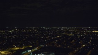 AX123_145 - 6K stock footage aerial video of residential neighborhoods at Night in Jamaica, New York