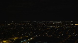 AX123_145E - 5.5K stock footage aerial video of residential neighborhoods at Night in Jamaica, New York