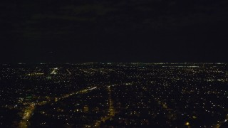 AX123_146 - 6K stock footage aerial video of suburban neighborhoods at Night in Elmont, Long Island, New York