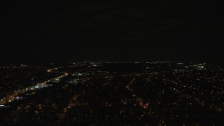 AX123_147 - 6K stock footage aerial video fly over suburban neighborhoods at Night in Elmont, Long Island, New York