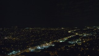 AX123_148 - 6K stock footage aerial video of a wide view of suburban neighborhoods at Night in Queens Village, NYC
