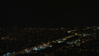 AX123_148E - 5.5K stock footage aerial video of a wide view of suburban neighborhoods at Night in Queens Village, NYC