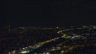 AX123_149 - 6K stock footage aerial video of Queens Village suburbs at Night in Queens, New York City