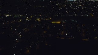 AX123_153 - 6K stock footage aerial video of flying over suburban homes at Night in Hempstead, New York