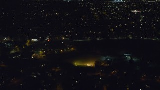AX123_154 - 6K stock footage aerial video fly over Hempstead neighborhoods at Night in New York