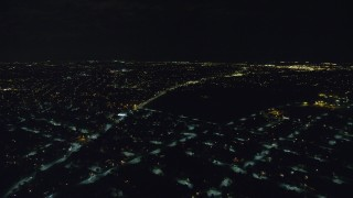 AX123_163 - 6K stock footage aerial video fly over residential neighborhoods at Night in Hempstead, New York