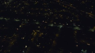 AX123_173 - 6K stock footage aerial video of a reverse view of freeway and suburban homes at Night in North Bellmore, New York
